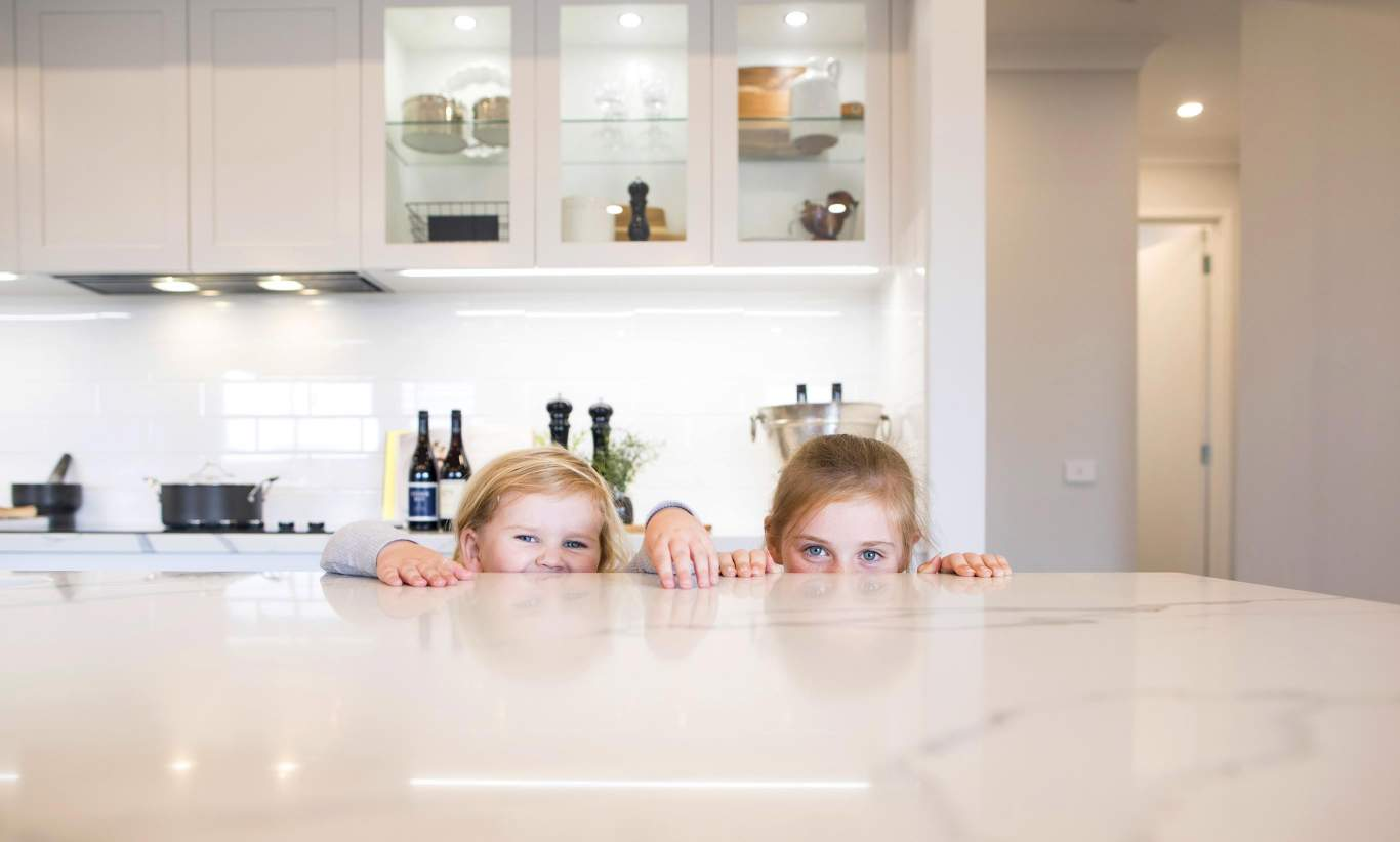 Kids playing in St Tropez Kitchen by  Wilson Homes